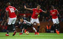 Manchester United's Nemanja Matic tackles Newcastle United's Dwight Gayle