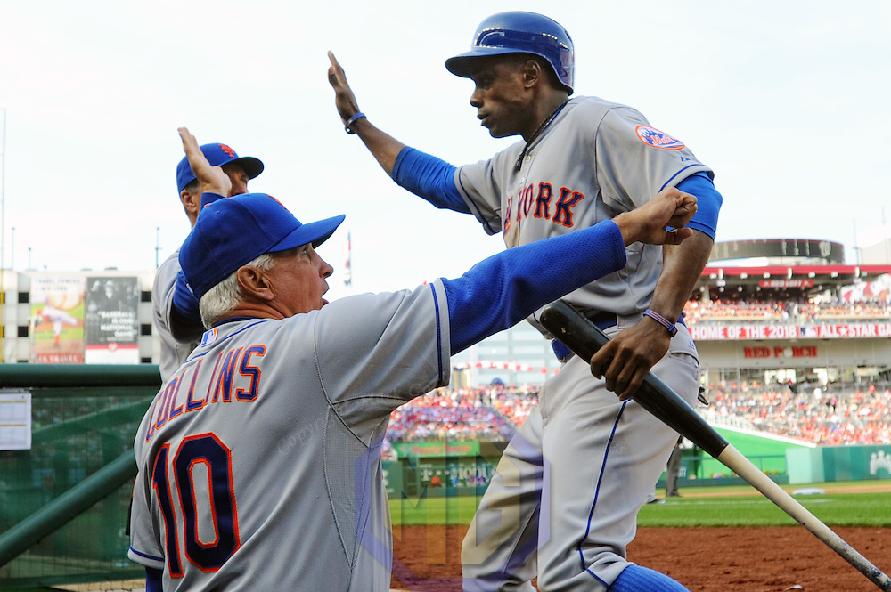 06 April 2015:  New York Mets right fielder Curtis Granderson (3) is congratulated by manager Terry Collins (10) after scoring on opening day at Nationals Park in Washington, D.C. where the New York Mets defeated the Washington Nationals, 3-1.