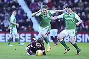 =47 Harry Cochrane under pressure from 8 Vykintas Slivka and 7 John McGinn during the William Hill Scottish Cup 4th round match between Heart of Midlothian and Hibernian at Tynecastle Stadium, Gorgie, Scotland on 21 January 2018. Photo by Kevin Murray.