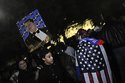 US Election Day 2012..After Obama is declared the victor, hundreds cheer outside the White House at midnight.