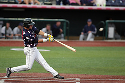 12 August 2011: Mike Mobbs takes a turn at the plate which results in a homerun during a game between the Rockford River Hawks and the Normal Cornbelters at the Corn Crib in Normal Illinois.