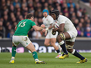 Twickenham. Great Britain.<br /> Maro ITOJE, driving towards Robbie HENSHAW, during the <br /> RBS Six Nations Rugby, England vs Ireland at the RFU Twickenham Stadium. England.<br /> <br /> Saturday  27/02/2016. <br /> <br /> [Mandatory Credit; Peter Spurrier/Intersport-images]