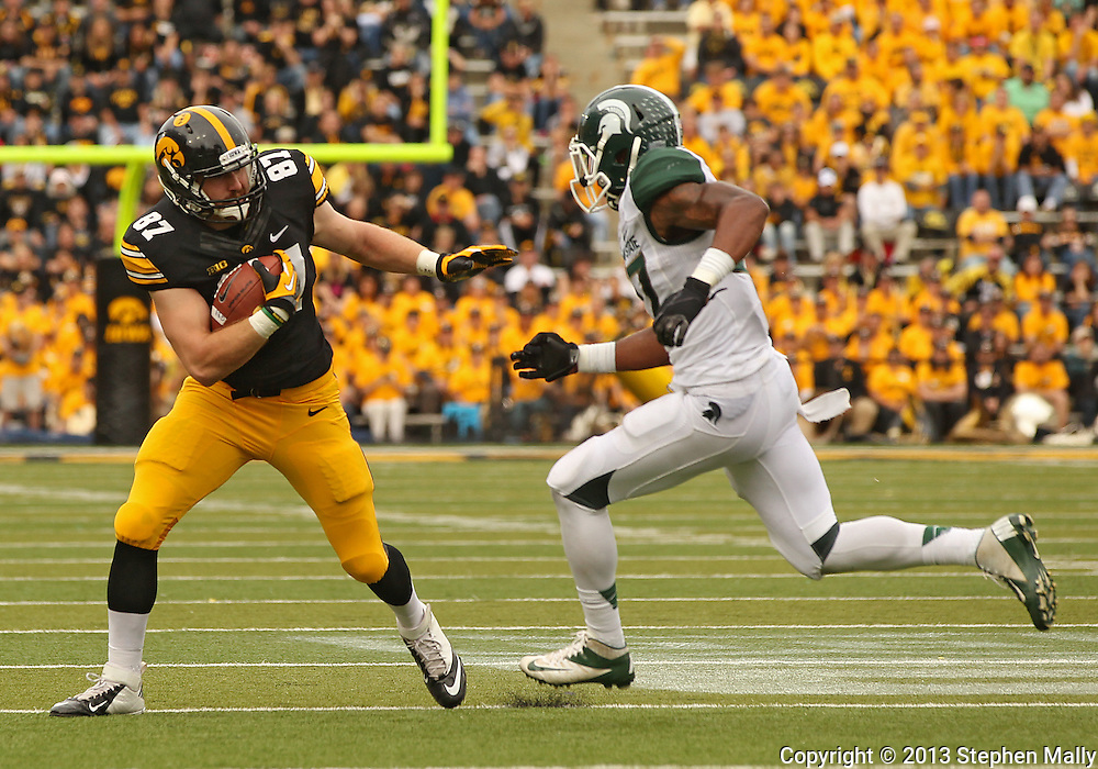 October 6 2013: Iowa Hawkeyes tight end Jake Duzey (87) tries to hold off Michigan State Spartans safety Kurtis Drummond (27) after a catch during the second half of the NCAA football game between the Michigan State Spartans and the Iowa Hawkeyes at Kinnick Stadium in Iowa City, Iowa on October 6, 2013. Michigan State defeated Iowa 26-14.