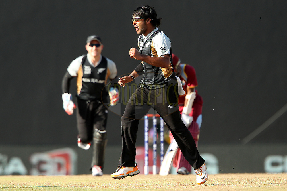 Roneel Hira celebrates the wicket of Denesh Ramdin of The West Indies during the ICC World Twenty20 Super Eights match between The West Indies and New Zealand held at the  Pallekele Stadium in Kandy, Sri Lanka on the 1st October 2012..Photo by Ron Gaunt/SPORTZPICS/PHOTOSPORT