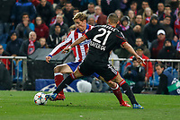 Atletico de Madrid´s Fernando Torres (L) and Bayer 04 Leverkusen´s Toprak during the UEFA Champions League round of 16 second leg match between Atletico de Madrid and Bayer 04 Leverkusen at Vicente Calderon stadium in Madrid, Spain. March 17, 2015. (ALTERPHOTOS/Victor Blanco)