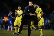AFC Wimbledon manager Neal Ardley hugs AFC Wimbledon striker Andy Barcham (17) at the final whistle during the EFL Sky Bet League 1 match between Gillingham and AFC Wimbledon at the MEMS Priestfield Stadium, Gillingham, England on 21 February 2017.