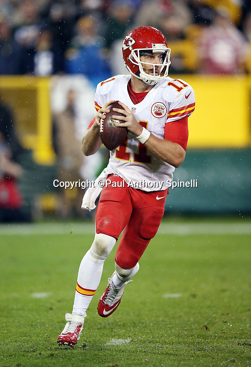 Kansas City Chiefs quarterback Alex Smith (11) rolls out while looking to pass during the 2015 NFL week 3 regular season football game against the Green Bay Packers on Monday, Sept. 28, 2015 in Green Bay, Wis. The Packers won the game 38-28. (©Paul Anthony Spinelli)