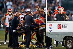 OAKLAND, CA - NOVEMBER 17: Wide receiver Auden Tate #19 of the Cincinnati Bengals is loaded into a cart after sustaining an injury during the fourth quarter against the Oakland Raiders at RingCentral Coliseum on November 17, 2019 in Oakland, California. The Oakland Raiders defeated the Cincinnati Bengals 17-10. (Photo by Jason O. Watson/Getty Images) *** Local Caption *** Auden Tate