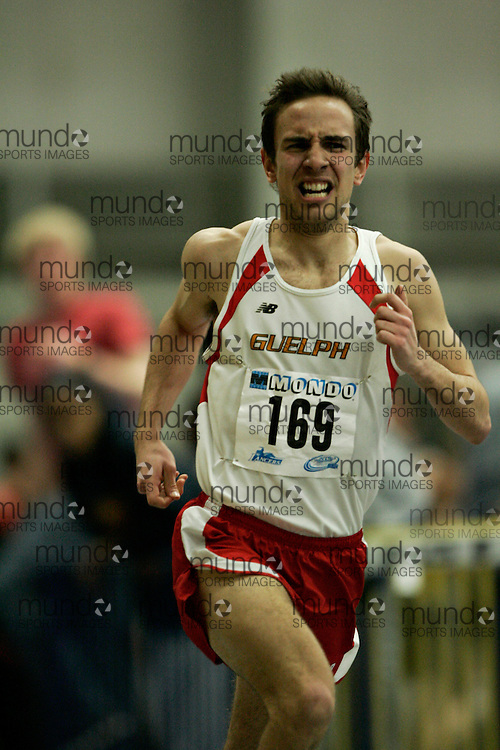 (Windsor, Ontario---13 March 2010) Allan Brett of University of Guelph Gryphons  competes in the men's 1500 meters at the 2010 Canadian Interuniversity Sport Track and Field Championships at the St. Denis Center. Photograph copyright GEOFF ROBINS/Mundo Sport Images. www.mundosportimages.com