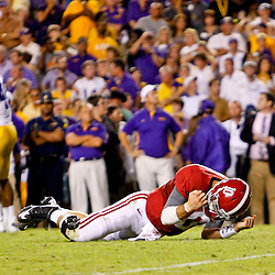 November 3, 2012; Baton Rouge, LA, USA;  Alabama Crimson Tide quarterback AJ McCarron (10) falls to the ground in celebration after throwing a game winning touchdown against the LSU Tigers during the fourth quarter of a game at Tiger Stadium. Alabama defeated LSU 21-17. Mandatory Credit: Derick E. Hingle-US PRESSWIRE