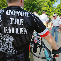 James Wiggins shows his suppport for the military at Monday's Memorial Day service at Veterans Park in Tupelo.