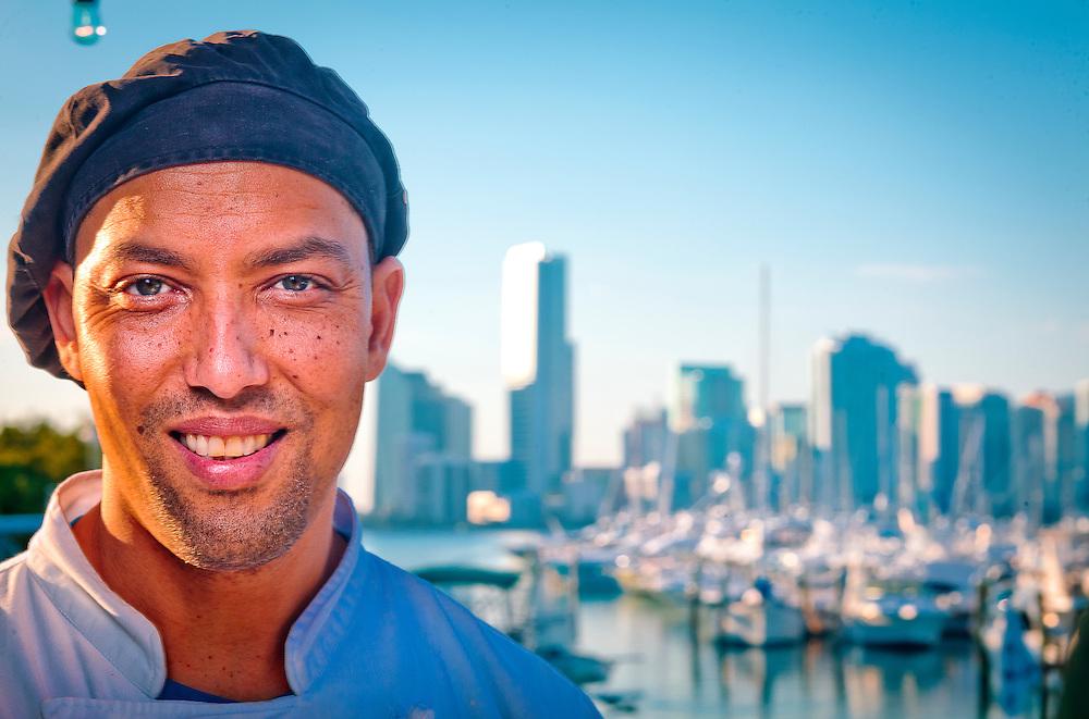 Chef Keith Conow at Rickenbacker's on Virginia Key, overlooking a marina and the Miami skyline