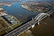Nederland, Zuid-Holland, Rotterdam, 20-03-2009; Van Brienenoordbrug over de Nieuwe Maas, met autoweg A16 gezien naar het Zuidoosten (richting Ridderkerk). Linksboven de afsplitsing van de Nieuwe Maas, de Hollandsche IJssel. Midden links kantoren aan het water in Kralingse Veer (deelgemeente Prins Alexander), rechts flats en eengezinswoningen in Oud-IJsselmonde en Beverwaard.  Air view on the river Meuse of Rotterdam Bottom the double bridge (Van Brienenoord) of the motorway A16, connecting the north and the south bank of the river. The river branches off into two rivers (top left)..Swart collectie, luchtfoto (toeslag); Swart Collection, aerial photo (additional fee required).foto Siebe Swart / photo Siebe Swart