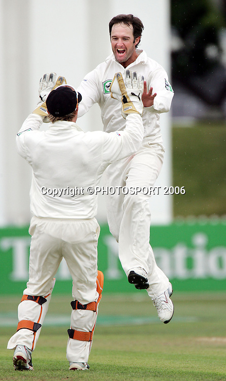 Nathan Astle leaps towards Brendan McCullum to celebrate the dismisal of Brian Lara on day 3 of the 2nd cricket test between New Zealand and West Indies at the Basin Reserve, Wellington, on Sunday 19 March, 2006. Photo: Andrew Cornaga/PHOTOSPORT<br />