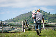 Father and son on ranch outside of Salmon, Idaho.