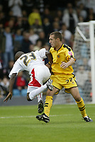 Photo: Marc Atkins.<br />Milton Keynes Dons v Notts County. Coca Cola League 2. 02/09/2006. Lloyd Dyer (L) of MK Dons goes don under a challenge from Notts County's John Hastings.