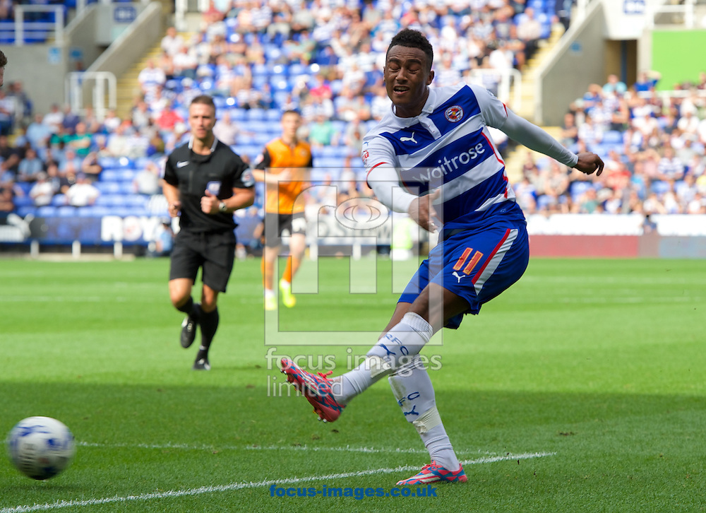 Jordan Obita of Reading has a shot on goal during the Sky Bet Championship match at the Madejski Stadium, Reading<br /> Picture by Alan Stanford/Focus Images Ltd +44 7915 056117<br /> 28/09/2014
