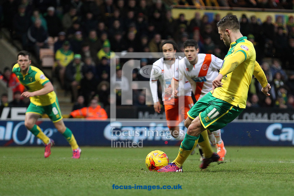 Gary Hooper of Norwich scores his sides 3rd goal from the penalty spot and completes his hat trick during the Sky Bet Championship match at Carrow Road, Norwich<br /> Picture by Paul Chesterton/Focus Images Ltd +44 7904 640267<br /> 07/02/2015