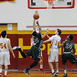 TOM KELLY IV &mdash; DAILY TIMES<br /> Haverford's Sean McClatchy (11) blocks a shot from Ridley's Ameer Staggs (23) in the final moments of Friday nights game at Haverford.