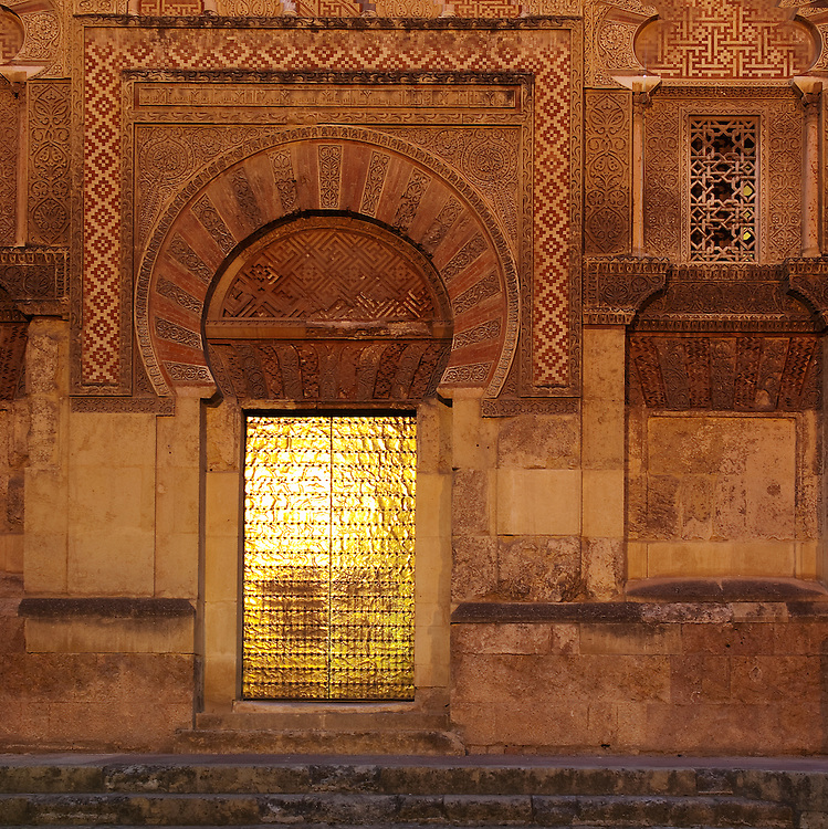 Early evening light reflects off the golden doors of the Mezquita.