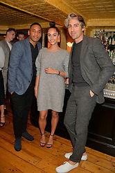 Left to right, REGGIE YATES, TIA WARD and GEORGE LAMB at the Kiehl's Icons VIP Dinner held at the Balthazar Dining Room, Wellington Street, London on 26th March 2014.