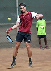 Moez Echargui of Tunisia returns a shot to Denis Indondo of Congo during their 14th African Nations Cup (CAN) 2016 teams competition at Nairobi Club on November 12, 2016. Idondo won 4-6, 6-0, 6-1. Photo/Fredrick Onyango/www.pic-centre.com (KEN)