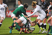 England player Male Packer is tackled hard by the Irish defence in the first half  during the Women's 6 Nations match between Ireland Women and England Women at Energia Park, Dublin, Ireland on 1 February 2019.