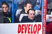 Unai Emery of Arsenal (Manager) sat on the Arsenal bench, with Denis Suarez of Arsenal (22) sat behind him during the Premier League match between Huddersfield Town and Arsenal at the John Smiths Stadium, Huddersfield, England on 9 February 2019.