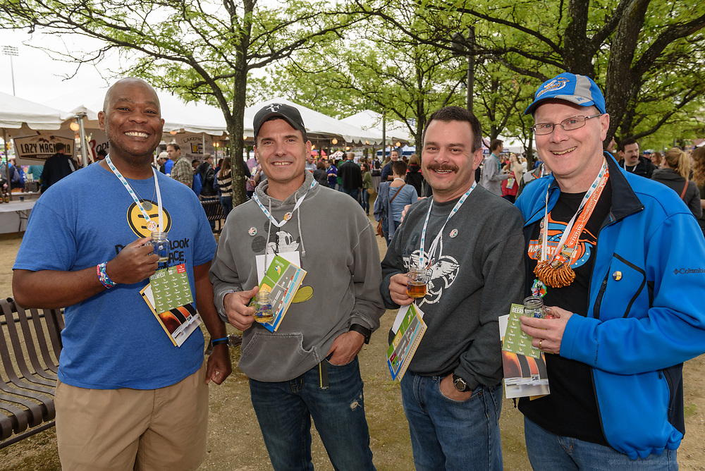 Fans sample regional and national craft beers at the Kentucky Derby Festival BeerFest, Presented by American Founders Bank, Wednesday, May 3, 2017, at the Overlook inside Kroger's Fest-A-Ville at Waterfront Park in Louisville, Ky. (Photo by Brian Bohannon)
