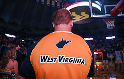 Dec 5, 2017; Morgantown, WV, USA; A West Virginia Mountaineers cheerleader pauses during the National Anthem before their game against the Virginia Cavaliers at WVU Coliseum. Mandatory Credit: Ben Queen-USA TODAY Sports