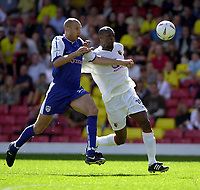 Photo. Richard Page<br />Watford v Millwall. Nationwide Division One. 13/09/2003.<br />Marcus Gayle holds off Bob Peeters.