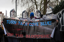 London, February 20th 2015. Scores of protesters demonstrate outside the Japanese embassy in London against the killing of dolphins in Taiji Action Day For Dolphins. The demonstrations are a regular occurrence, held by animal rights campaigners who oppose the slaughter of dolphins in Japan's Taiji Cove as well as tourist attractions where dolphins and killer whales are held in captivity.