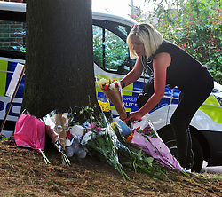 © Licensed to London News Pictures. 01/09/2016. Flowers and police at Lennard Road,Penge, the scene of yesterdays car chase which left a 10 year old boy and his aunt dead.<br />