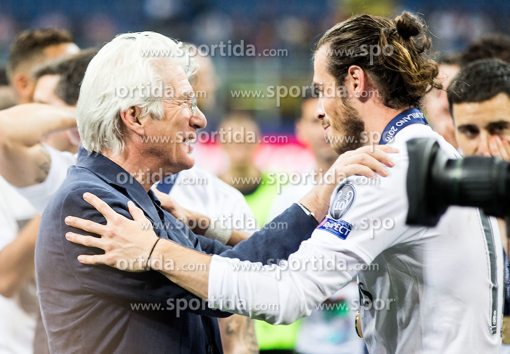 Actor Richard Gere and Gareth Bale of Real Madrid celebrate after winning during football match between Real Madrid (ESP) and Atlético de Madrid (ESP) in Final of UEFA Champions League 2016, on May 28, 2016 in San Siro Stadium, Milan, Italy. Photo by Vid Ponikvar / Sportida