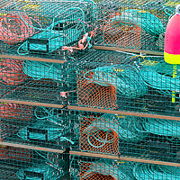 Stacks of lobster pots stand ready for the season. Bernard, Maine.