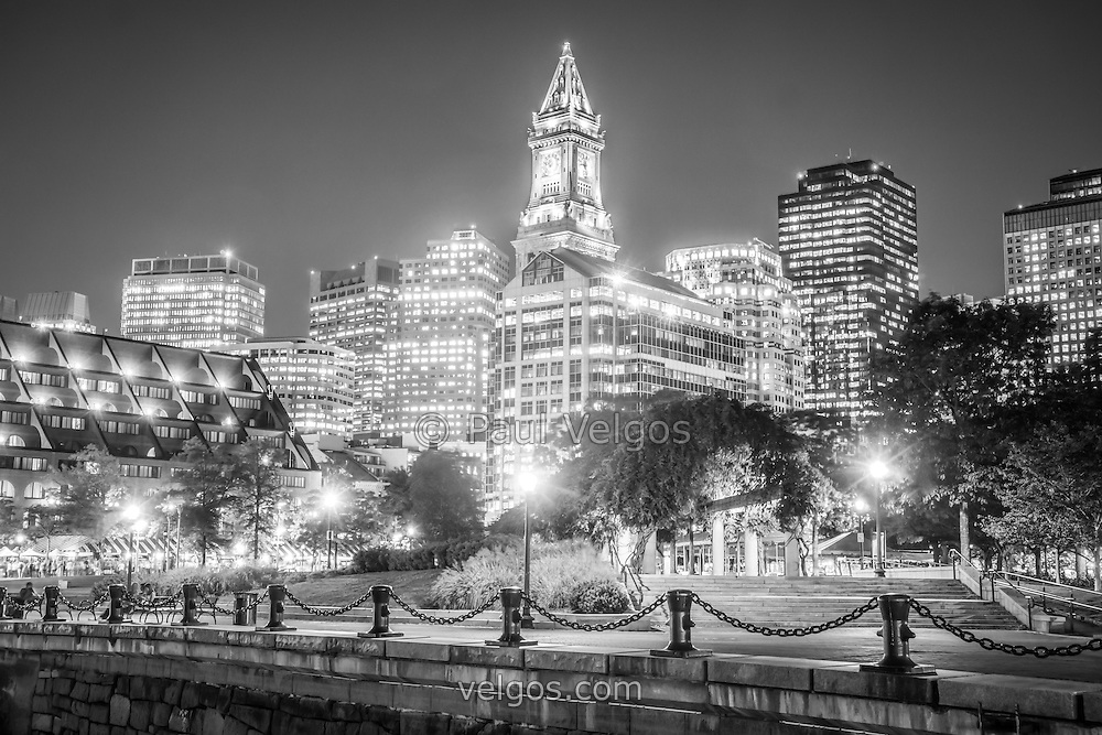 Boston skyline at night in black and white with christopher columbus waterfront park custom house