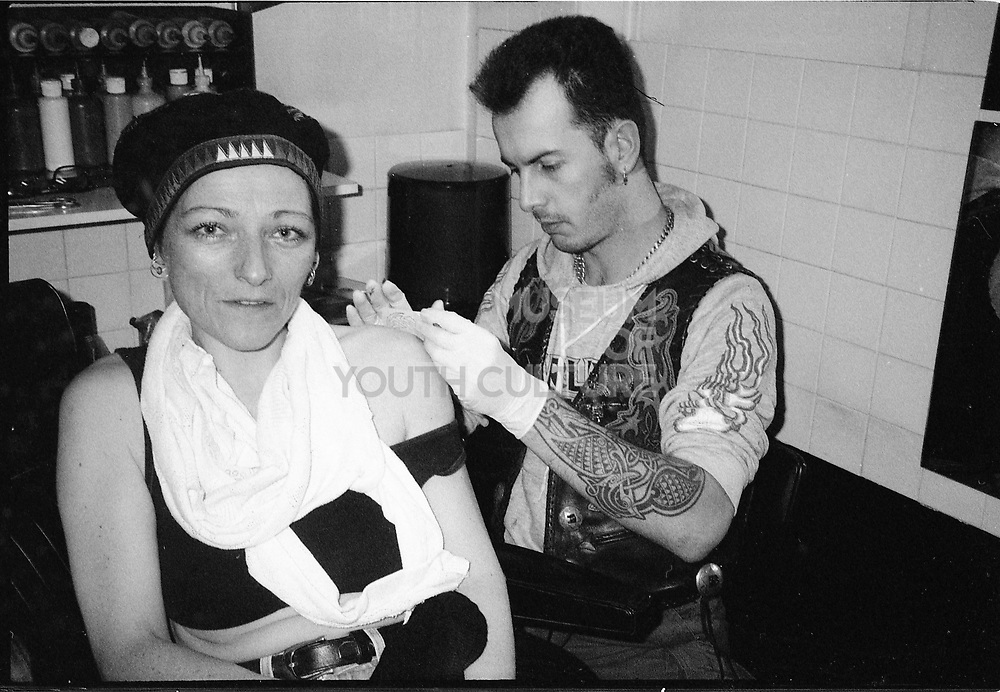 Woman Being Tattooed, UK. 1980s.