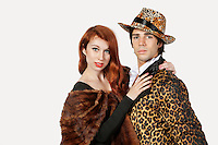 Portrait of couple in fur costume over gray background