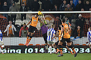 Hull City striker Chuba Akpom (19) tries to head the ball into the goal past Keiren Westwood of Sheffield Wednesday  during the Sky Bet Championship match between Hull City and Sheffield Wednesday at the KC Stadium, Kingston upon Hull, England on 26 February 2016. Photo by Ian Lyall.
