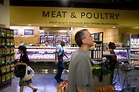 9 July, 2008. New York, NY. Customers in front of the meat and poultry section of the Whole Foods in Tribeca. A new assortment of kabobs and spiedini is presented at the meat and poultry section of the Whole Foods Market, which opened in Tribeca today,  on July 9th 2008.<br /> <br /> ©2008 Gianni Cipriano for The New York Times<br /> cell. +1 646 465 2168 (USA)<br /> cell. +1 328 567 7923 (Italy)<br /> gianni@giannicipriano.com<br /> www.giannicipriano.com