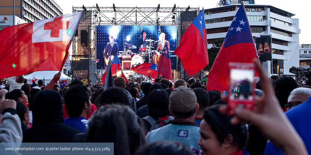 Large screen televised Finn brothers concert. Quay Street, downtown Auckland. Rugby World Cup 2011 opening night.