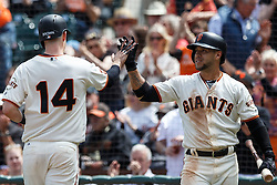 SAN FRANCISCO, CA - MAY 25: Trevor Brown #14 of the San Francisco Giants is congratulated by Gregor Blanco #7 after scoring a run against the San Diego Padres during the seventh inning at AT&T Park on May 25, 2016 in San Francisco, California.  (Photo by Jason O. Watson/Getty Images) *** Local Caption *** Trevor Brown; Gregor Blanco