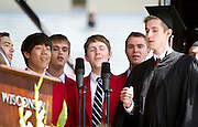 The MadHatters acapella group perform during the University of Wisconsin-Madison commencement ceremony at Camp Randall Stadium, Saturday, May 17, 2014.