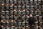 "Brewmaster Joachim Rösch stands next to barrels of beer at the Ganter Brewery in Freiburg im Breisgau, Germany.  (Joachim Rösch  is featured in the book What I Eat: Around the World in 80 Diets.)  The caloric value of his day's worth of food in March was 2700 kcals. He is 44 years of age; 6 feet, 2 inches tall; and 207 pounds. Joachim's job requires him to taste beer a number of times during the week, and unlike in wine tasting, he can't just taste then spit it out: ""Once you've got the bitter on the back of your tongue, you automatically get the swallow reflex, so down the chute you go,"" he says. MODEL RELEASED."