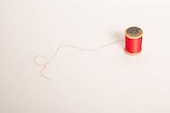 Still life photo of a vintage red thread. 7.10.16