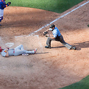 NEW YORK, NEW YORK - July 26: Matt Adams #32 of the St. Louis Cardinals is tagged out at home plate by Rene Rivera #44 of the New York Mets as umpire Stu Scheurwater # 85  makes the call during the St. Louis Cardinals Vs New York Mets regular season MLB game at Citi Field on July 26, 2016 in New York City. (Photo by Tim Clayton/Corbis via Getty Images)