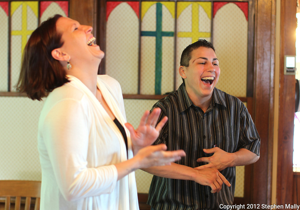 Brigg McDonald (from left) laughs as Stephany Lee struggles to get her wedding ring off her finger before the start of their ceremony at a wedding chapel in Cedar Rapids on Monday, April 23, 2012.