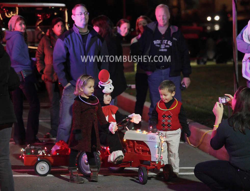 Town of Wallkill, New York  - Children pose for photographs after watching the Holiday Parade and Tree Lighting in front of Town Hall on Saturday, Nov. 26, 2012.