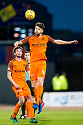 Dundee United defender Mark Durnan (#4) heads the ball clear of danger during the Betfred Scottish Cup match between Dundee and Dundee United at Dens Park, Dundee, Scotland on 9 August 2017. Photo by Craig Doyle.