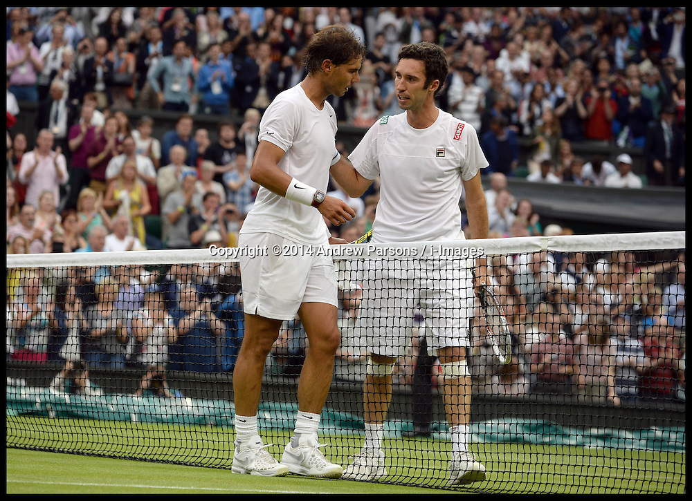 Image ©Licensed to i-Images Picture Agency. 28/06/2014. London, United Kingdom. Rafael Nadal celebrates beating Mikhail Kukushkin on centre court on Day 6 of the Wimbledon Championship. Picture by Andrew Parsons / i-Images